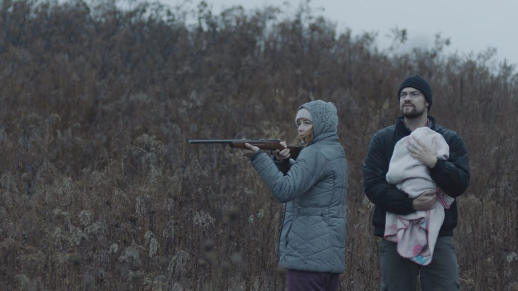 Lucy Walters as Ann and Shane West as Jason in HERE ALONE. Cinematographer: Adam McDaid