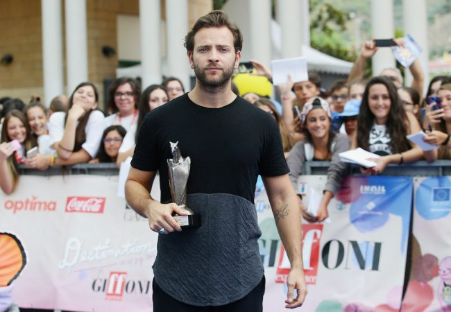 GIFFONI VALLE PIANA, ITALY - JULY 15: Actor Italian actor, Alessandro Borghi poses with the Giffoni Award on July 15, 2016 in Salerno, Italy. (Photo by Vittorio Zunino Celotto/Getty Images for Giffoni Film Festival)