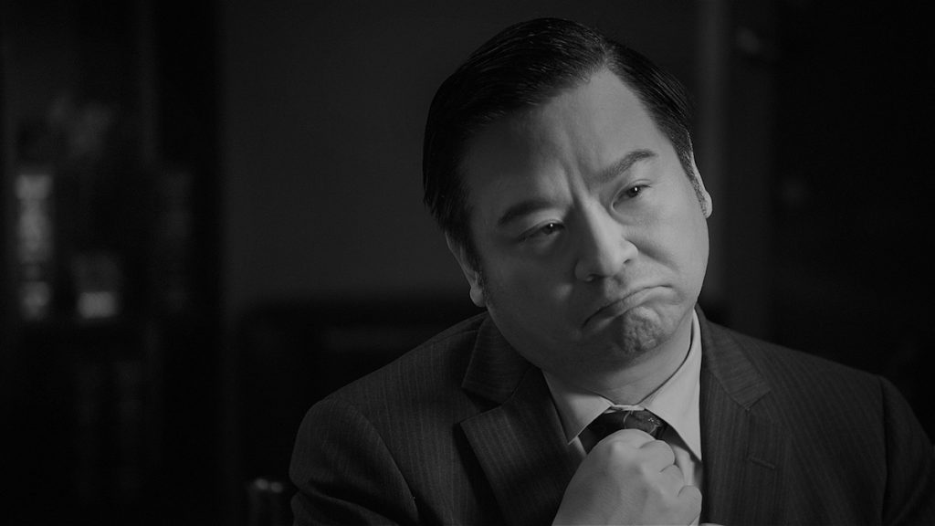 Rex Lee as'The Investor' in Guys Reading Poems