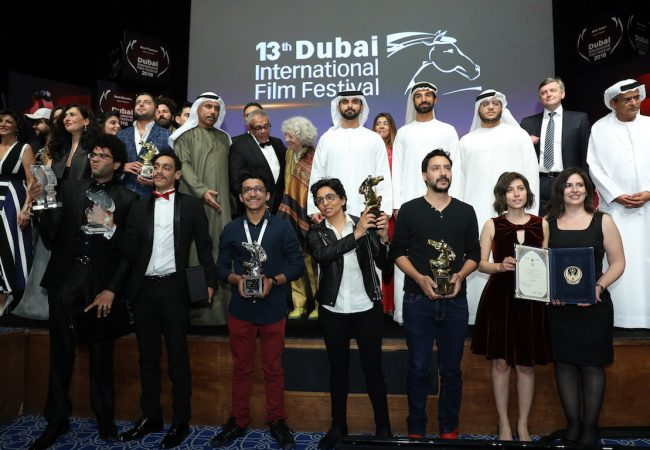 DUBAI, UNITED ARAB EMIRATES - DECEMBER 14: Sheikh Mansoor bin Mohammed bin Rashid Al Maktoum (C) with award winners during the Muhr Awards on day eight of the 13th annual Dubai International Film Festival held at the Madinat Jumeriah Complex on December 14, 2016 in Dubai, United Arab Emirates. (Photo by Neilson Barnard/Getty Images for DIFF)