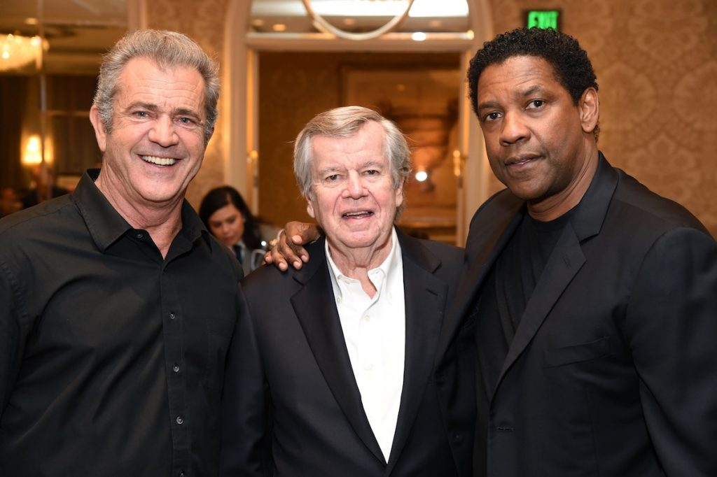 Mel Gibson, AFI Board of Directors Chair Robert A. Daly and Denzel Washington at the AFI AWARDS 2016 luncheon at the Four Seasons in Beverly Hills, CA, on January 6, 2017.