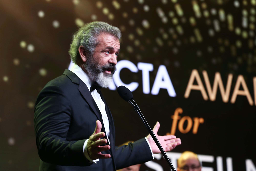 SYDNEY, AUSTRALIA - DECEMBER 07: Mel Gibson speaks after winning the AACTA Award for Best Film presented by Foxtel for Hacksaw Ridge during the 6th AACTA Awards Presented by Foxtel at The Star on December 7, 2016 in Sydney, Australia. (Photo by Mark Metcalfe/Getty Images for AFI) *** Local Caption *** Mel Gibson