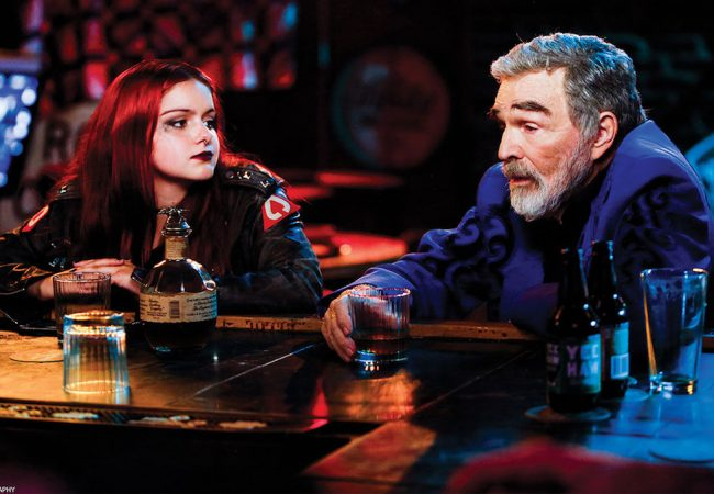 Vic Edwards (Burt Reynolds) and Ariel Winter (Lil) share a moment at McDougalís Pub in DOG YEARS. Photo by Bob Franklin.