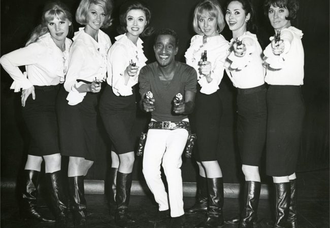 Sammy Davis, Jr. takes aim in a backstage photo with his dancers in a scene from the documentary SAMMY DAVIS, JR.: I'VE GOTTA BE ME. Photo Credit: The Estate of Altovise Davis