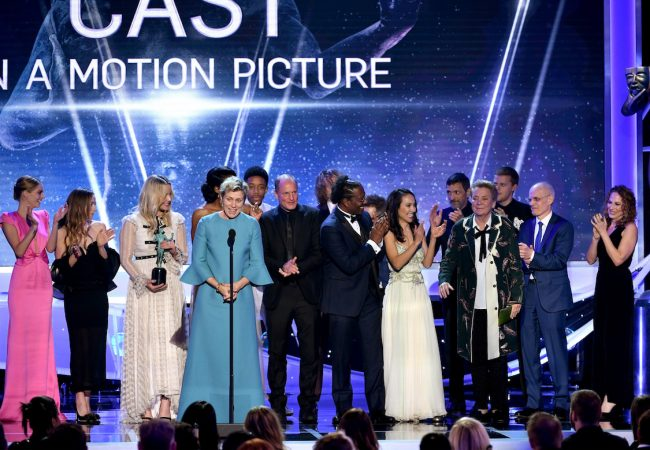 Actor Frances McDormand (4th from L, at microphone) and 'Three Billboards Outside Ebbing, Missouri' castmates accept the Outstanding Performance by a Cast in a Motion Picture award onstage during the 24th Annual Screen Actors Guild Awards