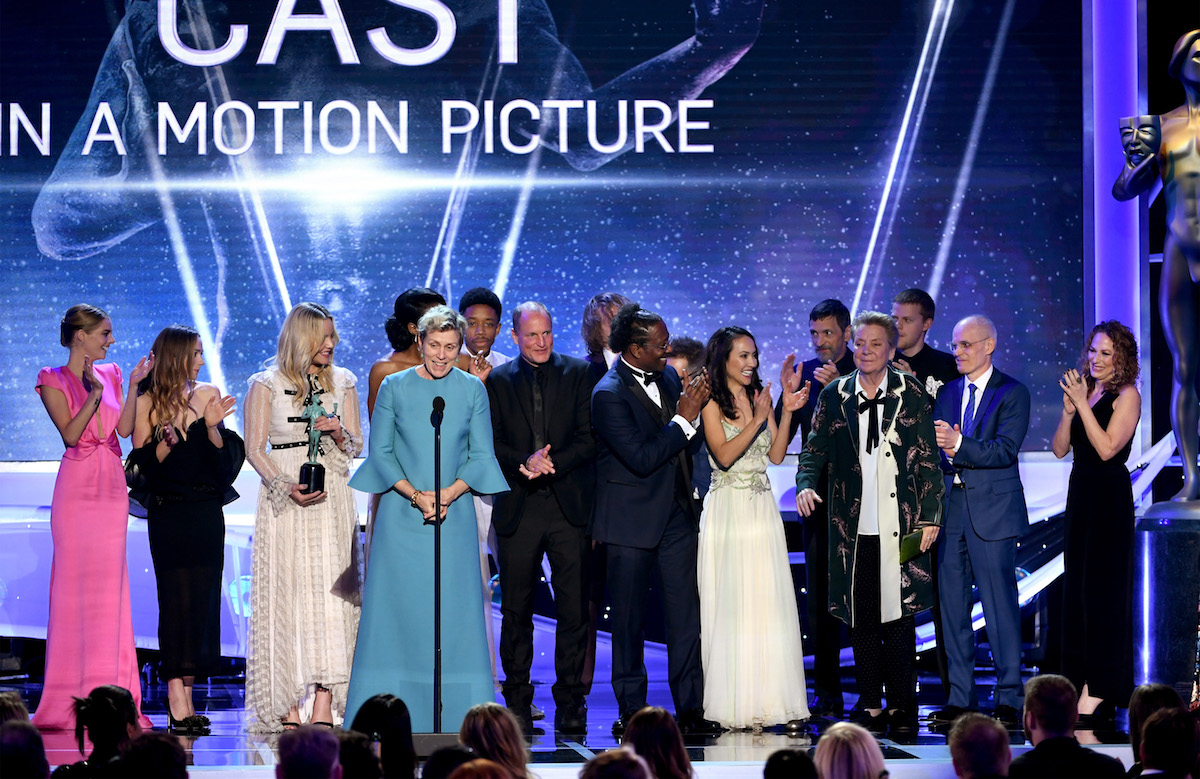LOS ANGELES, CA - JANUARY 21: Actor Frances McDormand (4th from L, at microphone) and'Three Billboards Outside Ebbing, Missouri' castmates accept the Outstanding Performance by a Cast in a Motion Picture award onstage during the 24th Annual Screen Actors Guild Awards at The Shrine Auditorium on January 21, 2018 in Los Angeles, California. 27522_013 (Photo by Kevin Winter/Getty Images) *** Local Caption *** Frances McDormand;Sam Rockwell;Darrell Britt-Gibson;Woody Harrelson;Abbie Cornish;Lucas Hedges;Zeljko Ivanek;John Hawkes;Samara Weaving;Sandy Martin;Amanda Warren