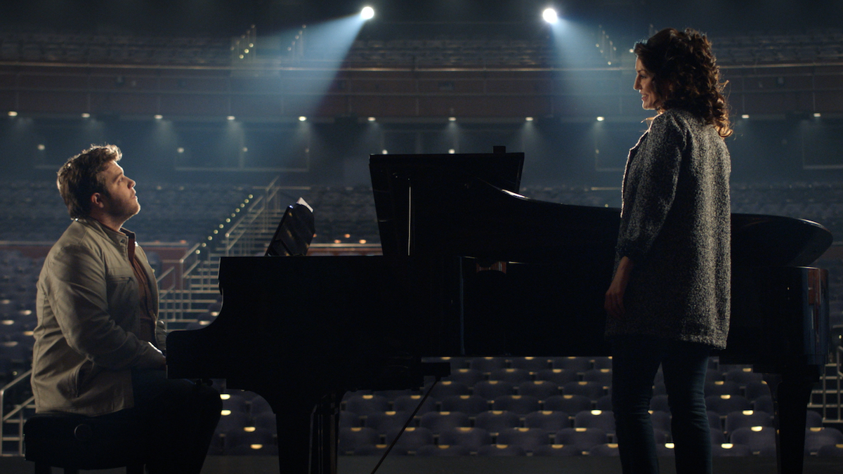 Bart Millard (John Michael Finley) and Amy Grant (Nicole DuPort) rehearse in the new film I CAN ONLY IMAGINE releasing March 16, 2018. Courtesy of Lionsgate and Roadside Attractions.