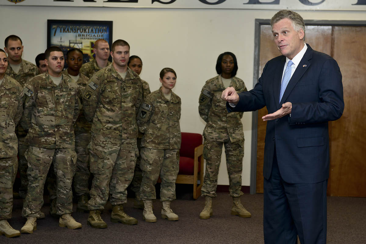 Terry McAuliffe, Virginia governor, meets with Soldiers during a visit to Fort Eustis, Va., Dec. 2, 2014. During his visit, McAuliffe asked the Soldiers questions about their military experiences, and thanked them for their service. (U.S. Air Force photo by Senior Airman Kimberly Nagle/Released)