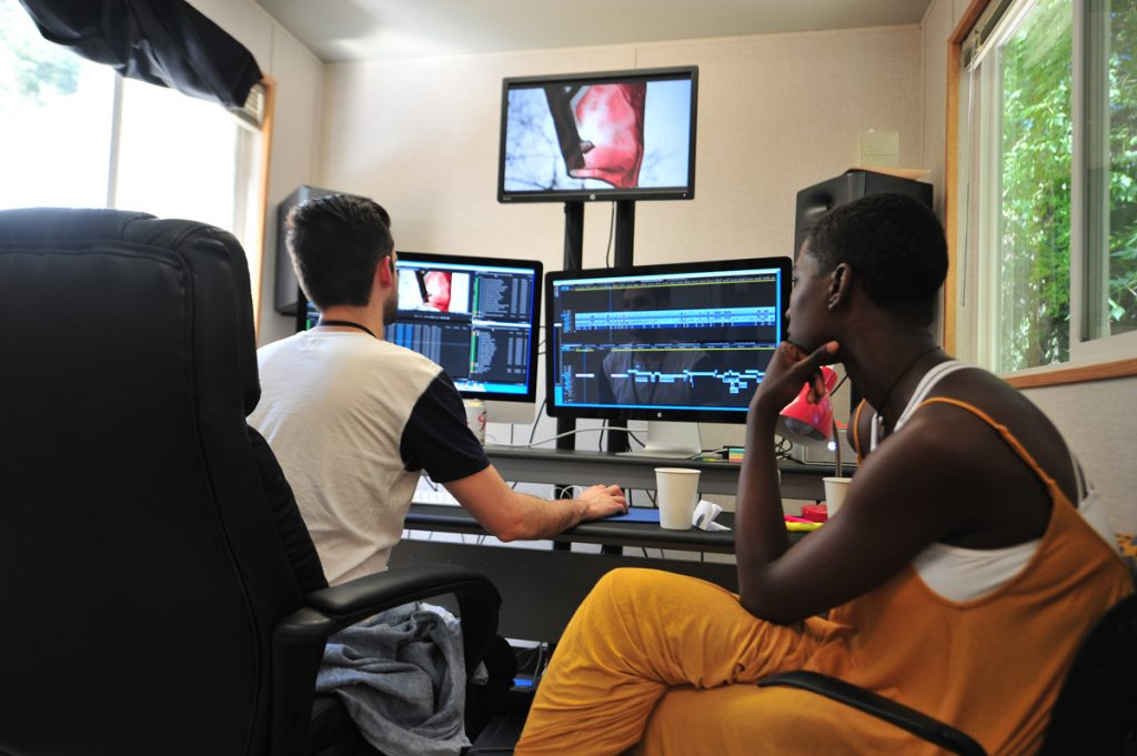 "Christopher McNabb, Damon Davis and Sabaah Folayan work on ""Whose Streets?"" at the 2016 Documentary Editing Lab. © 2016 Sundance Institute 