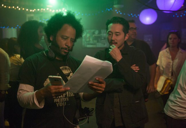(l to r.) Director Boots Riley and Steven Yeun on the set of SORRY TO BOTHER YOU, an Annapurna Pictures release.