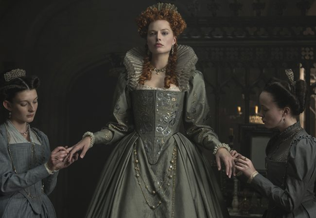 (l-r) Grace Molony stars as Dorothy Stafford, Margot Robbie stars as Queen Elizabeth I and Georgia Burnell as Kate Carey in MARY QUEEN OF SCOTS, a Focus Features release.