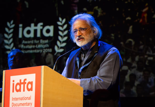 Anand Patwardhan (India), The IDFA Award for Best Feature-Length Documentary Film Reason, The film is a broad-ranging examination of Indian society, where secular rationalists are hunted down as they attempt to stem the rising tide of religious and nationalist fundamentalism. Photo: Nichon Glerum International Documentary Filmfestival Amsterdam 2018, Award Show in de Stadsschouwburg.