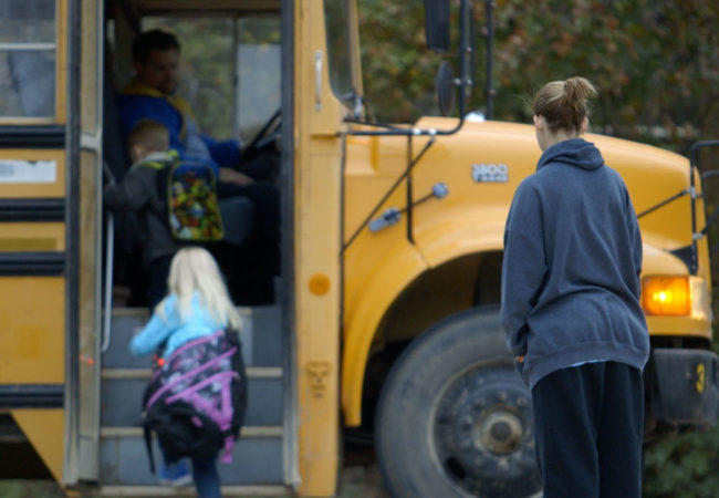UNTOUCHABLE - In Oklahoma Shawna Baldwin watches her children board a school bus.