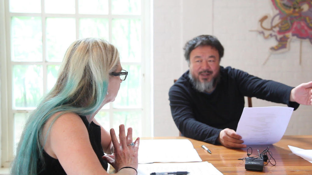 """""""AI WEIWEI: YOURS TRULY"""" director Cheryl Haines talking to Ai Weiwei about the exhibit in Alcatraz."""