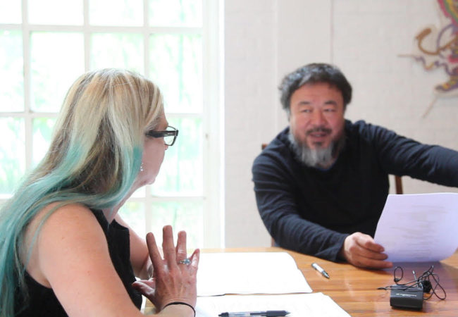 """AI WEIWEI: YOURS TRULY"" director Cheryl Haines talking to Ai Weiwei about the exhibit in Alcatraz."