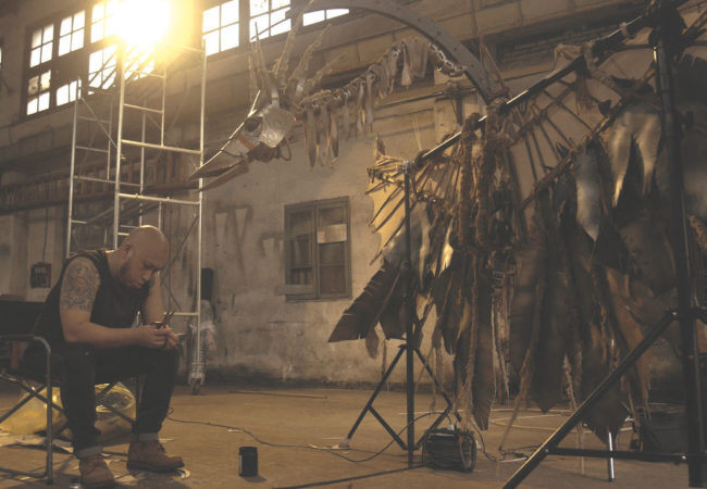 OUR TIME MACHINE. Maleonn working on bird sculpture. Courtesy Maleonn Studio.