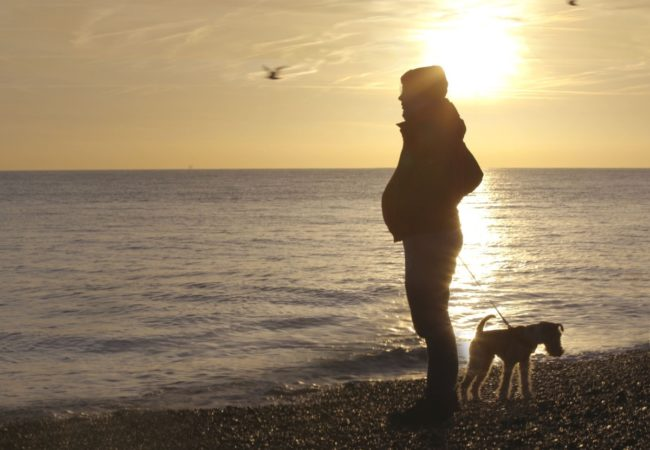 STILL FROM SEAHORSE. A British trans man, pregnant with his son walks on the beach.