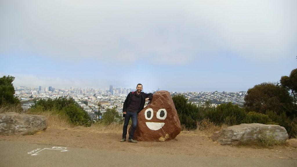 Picture Character. Linguist Tyler Schnoebelen with San Francisco's beloved poop rock.