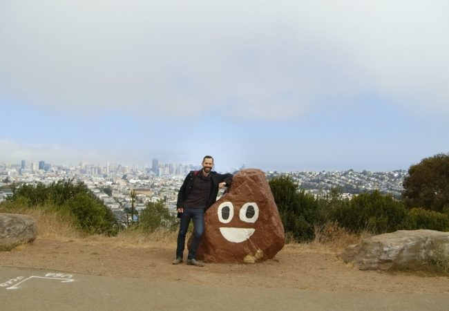 Picture Character. Linguist Tyler Schnoebelen with San Francisco's beloved poop rock.