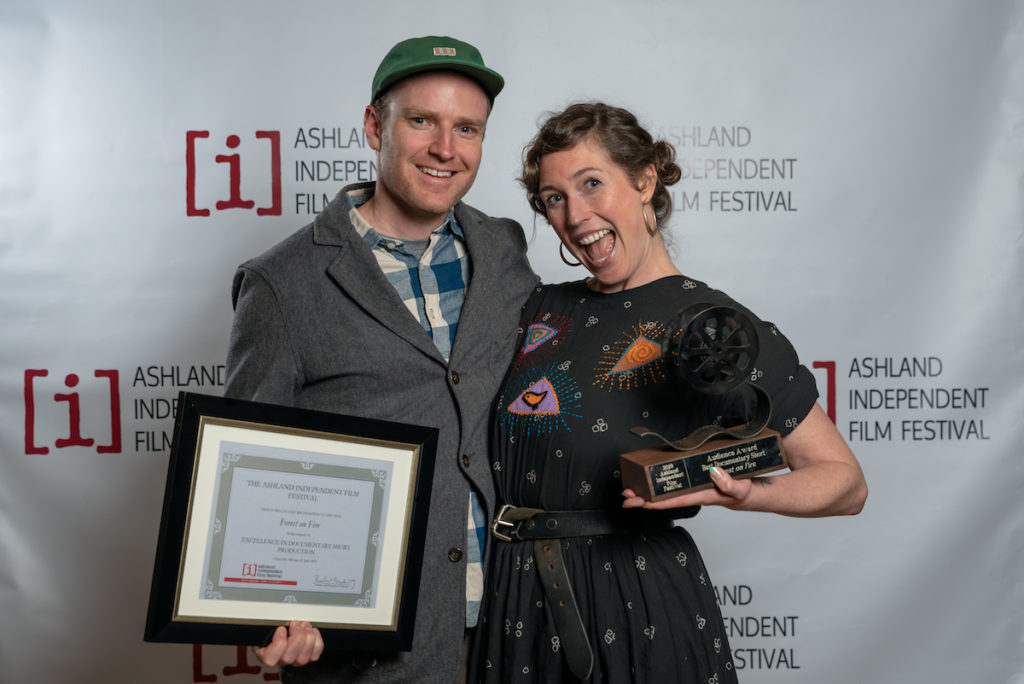 Filmmakers Reed Harkness and Heather Hawksford receive the audience award for Best Documentary Short and special jury recognition for Documentary Short Production for their film Forest on Fire. Photo by Kyle Asher, courtesy of the Ashland Independent Film Festival