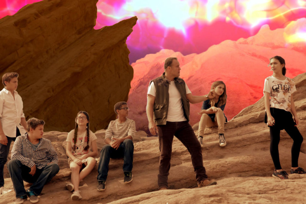 A WORLD AWAY. Resting on the ridge of beneath the sweltering sun. (L-R): Frank Lawrence Catania, Daniel Jenks, Landry Bender, Nathaniel J Potvin, David DeLuise, Carmen Blanchard, and Rowan Blanchard