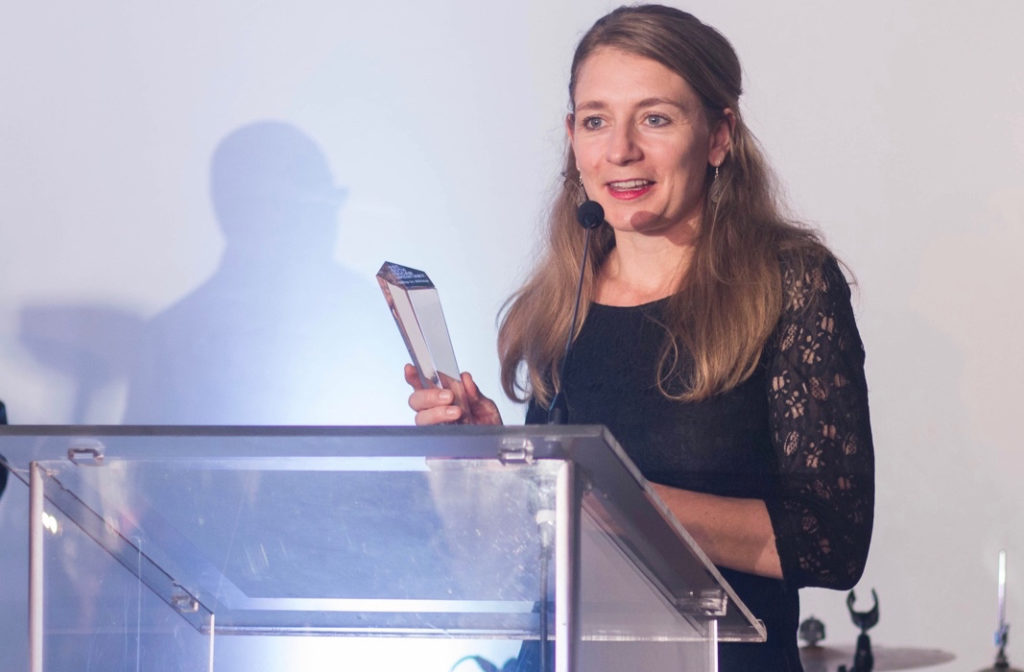 Nicole Schafer, director of Buddha in Africa accepts her award for Best South African Documentary at the 40th Durban International Film Festival