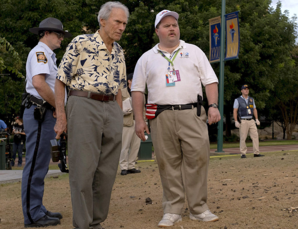 """(L-R) CLINT EASTWOOD and PAUL WALTER HAUSER on the set of Warner Bros. Pictures' """"RICHARD JEWELL,"""" a Warner Bros. Pictures release. Photo by Claire Folger"""