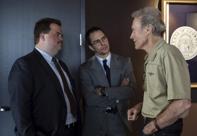 "(L-R) PAUL WALTER HAUSER, SAM ROCKWELL and CLINT EASTWOOD on the set of Warner Bros. Pictures' ""RICHARD JEWELL,"" a Warner Bros. Pictures release. Photo by Claire Folger"