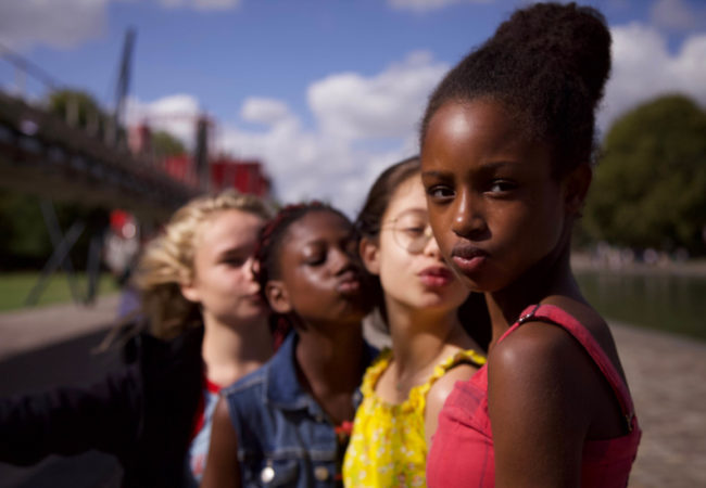 "Fathia Youssouf, Medina El Aidi-Azouni, Esther Gohourou, Ilanah Cami-Goursolas, Myriam Hamma, Demba Diaw, and Maimouna Gueye appear in ""Cuties"" by Maïmouna Doucouré, an official selection of the World Cinema Dramatic Competition at the 2020 Sundance Film Festival. Courtesy of Sundance Institute. 'Courtesy of Sundance Institute.'"