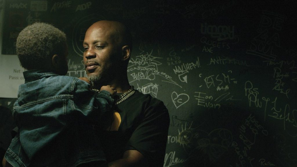 "Earl and Son Exodus share a moment backstage in DON'T TRY TO UNDERSTAND: A year in the Life of Earl ""DMX"" Simmons."