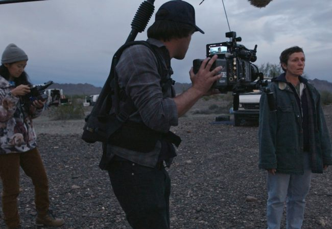 (From L-R): Director/Writer Chloé Zhao, Director of Photography Joshua James Richards and Frances McDormand on the set of NOMADLAND. Photo Courtesy of Searchlight Pictures. © 2020 20th Century Studios All Rights Reserved