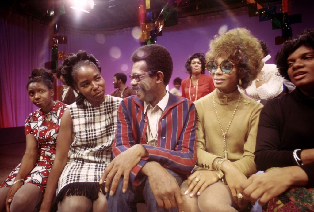 On the set of SOUL!, Host Ellils Haizlip (middle) is surrounded by members of the J.C. WHITE SINGERS after their moving performance