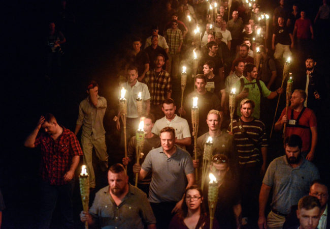 The Meaning of Hitler. White nationalists participate in a torch-lit march on the grounds of the University of Virginia ahead of the Unite the Right Rally in Charlottesville, Virginia on August 11, 2017. Picture taken August 11, 2017. REUTERS/Stephanie Keith