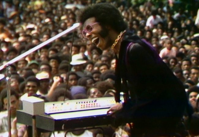 Sly Stone performing at the Harlem Cultural Festival in 1969, featured in the documentary SUMMER OF SOUL.