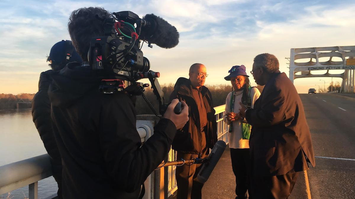 "Who We Are: A Chronicle of Racism in America. Jeffery Robinson with civil rights activist and lawyer Faya Ora Rose Touré and Senator Henry ""Hank"" Sanders on the Edmund Pettus Bridge in Selma, Alabama."