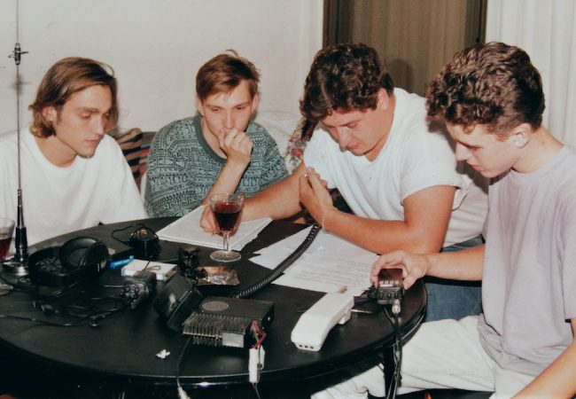 "Miracle Fishing: Kidnapped Abroad. One of the earliest radio negotiations. Jan 95. From Left: Miles, Geddie Hargrove, Robert Clerx (who was the ""voice"" on the radio), and Peter Greiner. Photo: Uli Greiner Photo courtesy: discovery+"