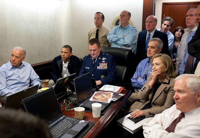"""Revealed: The Hunt for Bin Laden."" President Barack Obama and Vice President Joe Biden, along with with members of the national security team, receive an update on the mission against Osama bin Laden in the Situation Room of the White House, May 1, 2011. Please note: a classified document seen in this photograph has been obscured. (Official White House Photo by Pete Souza)."