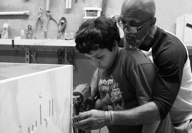 Twelve - year - old Furquan, learning how to build a casket with the help of Hanif, in Two Gods, directed by Zeshawn Ali. Photo credit: Zeshawn Ali