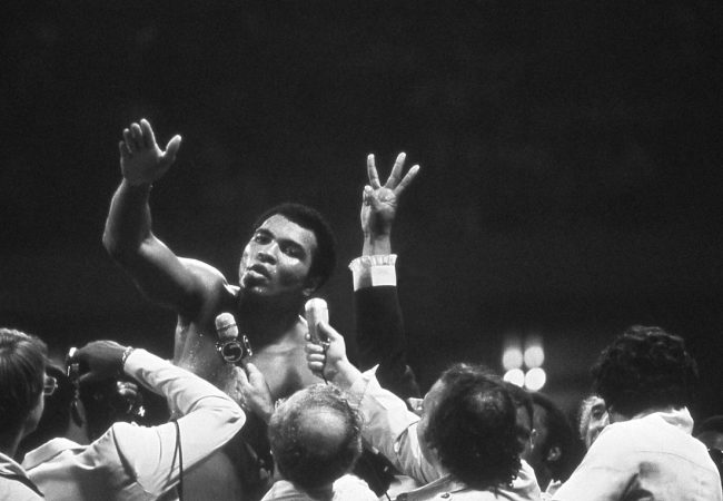 Muhammad Ali. Muhammad Ali talks with the press after winning back the Heavyweight Championship for an unprecedented third time by beating Leon Spinks at the Super Dome in New Orleans, LA. September 15, 1978. Credit: Courtesy of Michael Gaffney