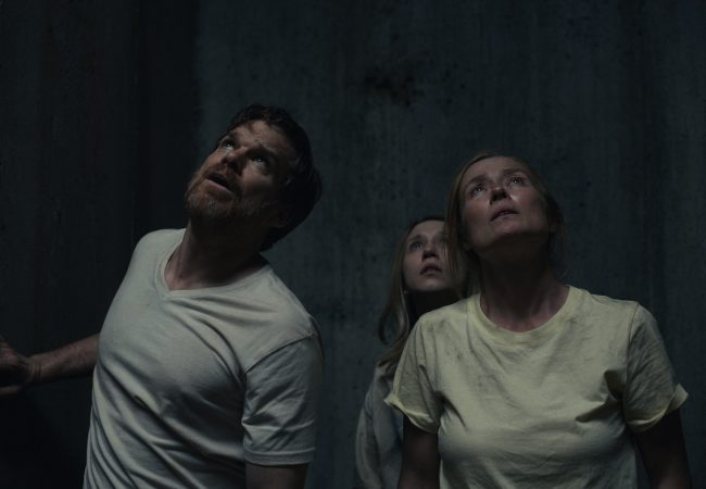 """Michael C. Hall as """"Brad,"""" Taissa Farmiga as """"Laurie,"""" and Jennifer Ehle as """"Anna"""" in Pascual Sisto's JOHN AND THE HOLE. (Courtesy of IFC Films. )"""